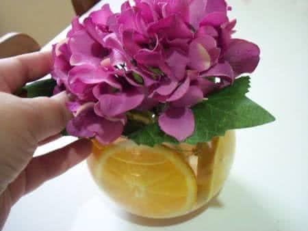 arranjo flores e laranjas