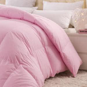 edredon rosa cama