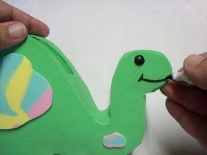 porta-celular dinossauro