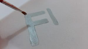 almofadas palavras stencil